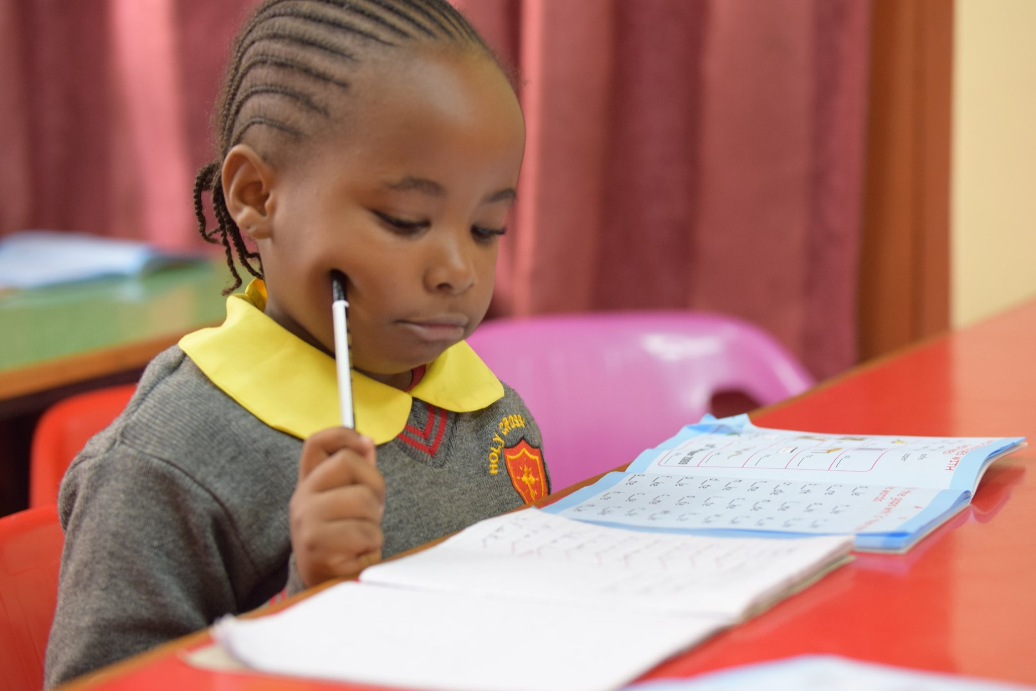 A student working at the Holy Cross Academy in Lavington - Kenya