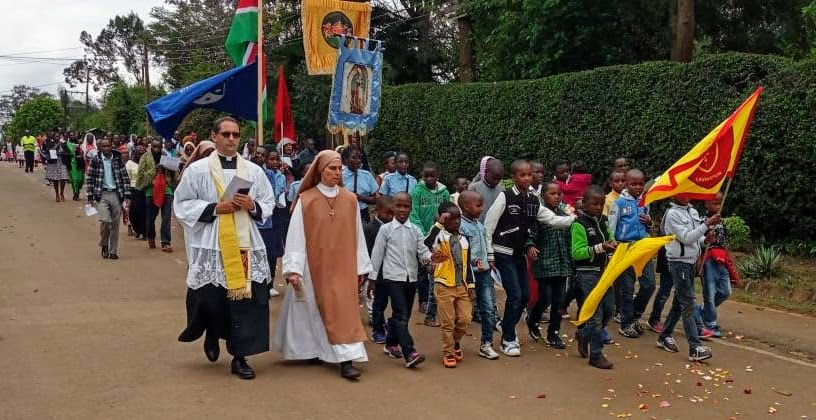 Students and parents make a Catholic procession at Holy cross academy church in Lavington - Kenya